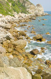 Beach with stone. Beautiful beach in Xichong of South China,lots of stones and blue sea water Stock Image