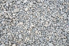 Beach stones background Stock Images
