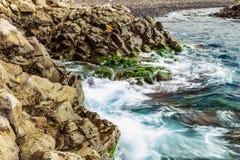 Beach Stones in Ocean Abstract Background Stock Photos
