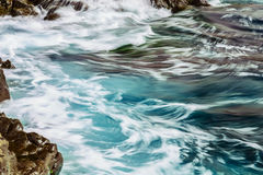 Beach Stones in Ocean Abstract Background Stock Image