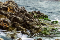 Beach Stones in Ocean Abstract Background Stock Photography