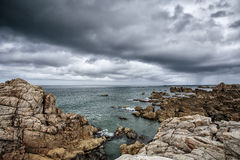 Beach and Stones at the Pink Granite Coast in Brittany France Stock Image