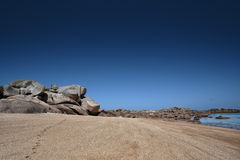 Beach and Stones at the Pink Granite Coast in Brittany France Royalty Free Stock Photography