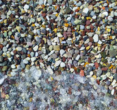 Beach stones and water Royalty Free Stock Images