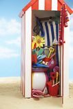 Beach storage cabin with beach toys Royalty Free Stock Photography