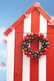 Beach storage cabin with christmas decoration on door Royalty Free Stock Images