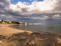Beach with storm clouds a sunset in the Mar Menor. A very touristy place Stock Photos