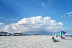 Beach before the storm. White sand beach against the backdrop of stormy clouds east coast USA stock photo