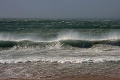 Beach stormy. Beach on a very stormy and windy day royalty free stock images
