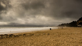 Beach with stormy clouds. Branksome Chine Beach, Bournemouth with a storm brewing stock photography