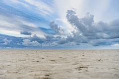 Beach with Stormy clouds and solitary beach Stock Image