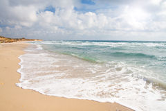 Beach and stormy sea Stock Image