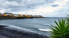 On the beach in stormy weather - La Caleta de Interián a small town located on the north coast of Tenerife between Los Silos and. Garachico stock image