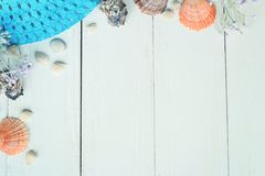Beach straw hat and seashells on a wooden background.photo with place for text Royalty Free Stock Photo