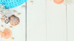 Beach straw hat and seashells on a wooden background.photo with place for text Stock Photo