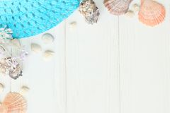 Beach straw hat and seashells on a wooden background.photo with place for text Royalty Free Stock Image