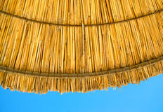 Beach straw parasol umbrella against the sky Stock Image