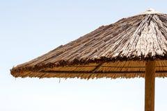 Beach straw umbrella Stock Image