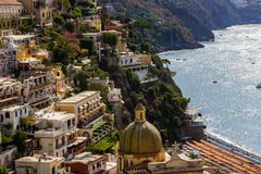 Positano on Amalfi Coast near Naples in Italy. Beach streets and colorful houses on the hill in Positano on Sorrento Peninsula in South Italy Royalty Free Stock Photography