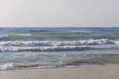 Beach with strong waves. La Zenia, Costa Blanca, Spain Royalty Free Stock Photography