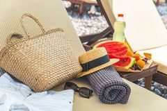 Free Beach Stuff Bag Towel Blanket On Sun Longer. Fruits On The Table. Summer Vacation Royalty Free Stock Images - 143009459