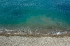 Beach stuff placed near sea. tropical turquoise blue sea. View from above. Royalty Free Stock Images