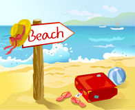 Beach with suitcase, accessories, and a pointer Royalty Free Stock Photos