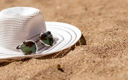 Beach with summer accessories. Sandy beach with summer accessories royalty free stock photography