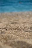 Beach summer background with sand and sea. Macro photography Stock Photography