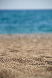 Beach summer background with sand and sea. Macro photography Royalty Free Stock Photo