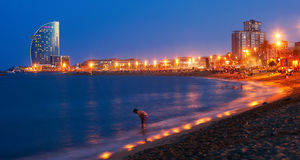 Beach in summer evening in Barcelona, Spain Stock Images