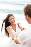 Beach summer vacation fun with playful couple Stock Photography