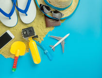 Beach Summer Vacation gadgets and fashion on blue Stock Photography