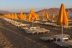 Beach sun beds and shade unbrellas. Royalty Free Stock Photos