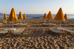 Beach sun beds and shade unbrellas. Royalty Free Stock Photography