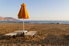 Beach sun beds and shade unbrellas. Stock Photos