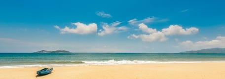 Beach in the sun. Boat Stock Photo