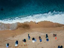 Beach with sun loungers on the coast of the ocean. Bird`s eye view royalty free stock photography