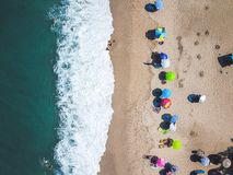 Beach with sun loungers on the coast of the ocean. Bird`s eye view stock image
