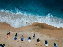 Beach with sun loungers on the coast of the ocean. Bird`s eye view stock images