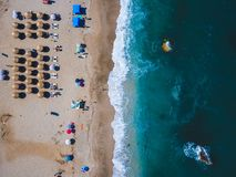 Beach with sun loungers on the coast of the ocean. Bird`s eye view stock photo