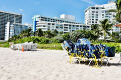 Beach sun loungers and lifejackets nearby hotels. There are general components of the beach industry , sun loungers and life jackets , ready in the morning for stock image