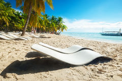 Beach with sun loungers Stock Image