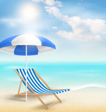 Beach with sun umbrella beach chair and clouds. Summer vacation Stock Photo