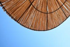 Beach sun umbrella made of bamboo. Stock Photos