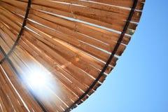 Beach sun umbrella made of bamboo with sunbeam. Beach sun umbrella made of bamboo.n Royalty Free Stock Photo