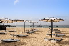 Beach with sun umbrellas and beds royalty free stock image