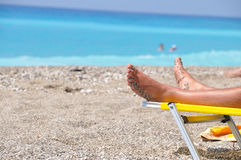 Beach sunbath. Sunbath to beach with blue clean water Royalty Free Stock Image