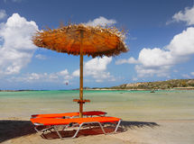 Beach, Sunbed and Umbrella Royalty Free Stock Photo