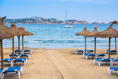 Beach sunbeds. Empty summer beach sunbeds and umbrellas at Majorca (Mallorca) Paguera beach Stock Photo